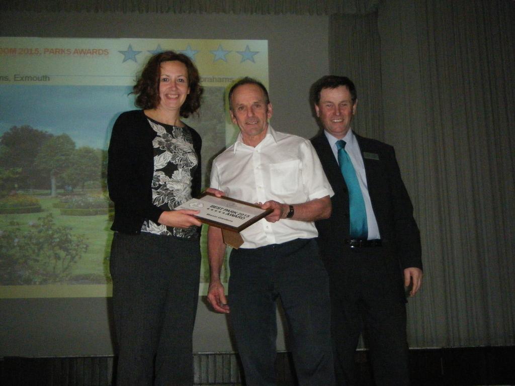 Jane & Mike receive award from Roger Burnett