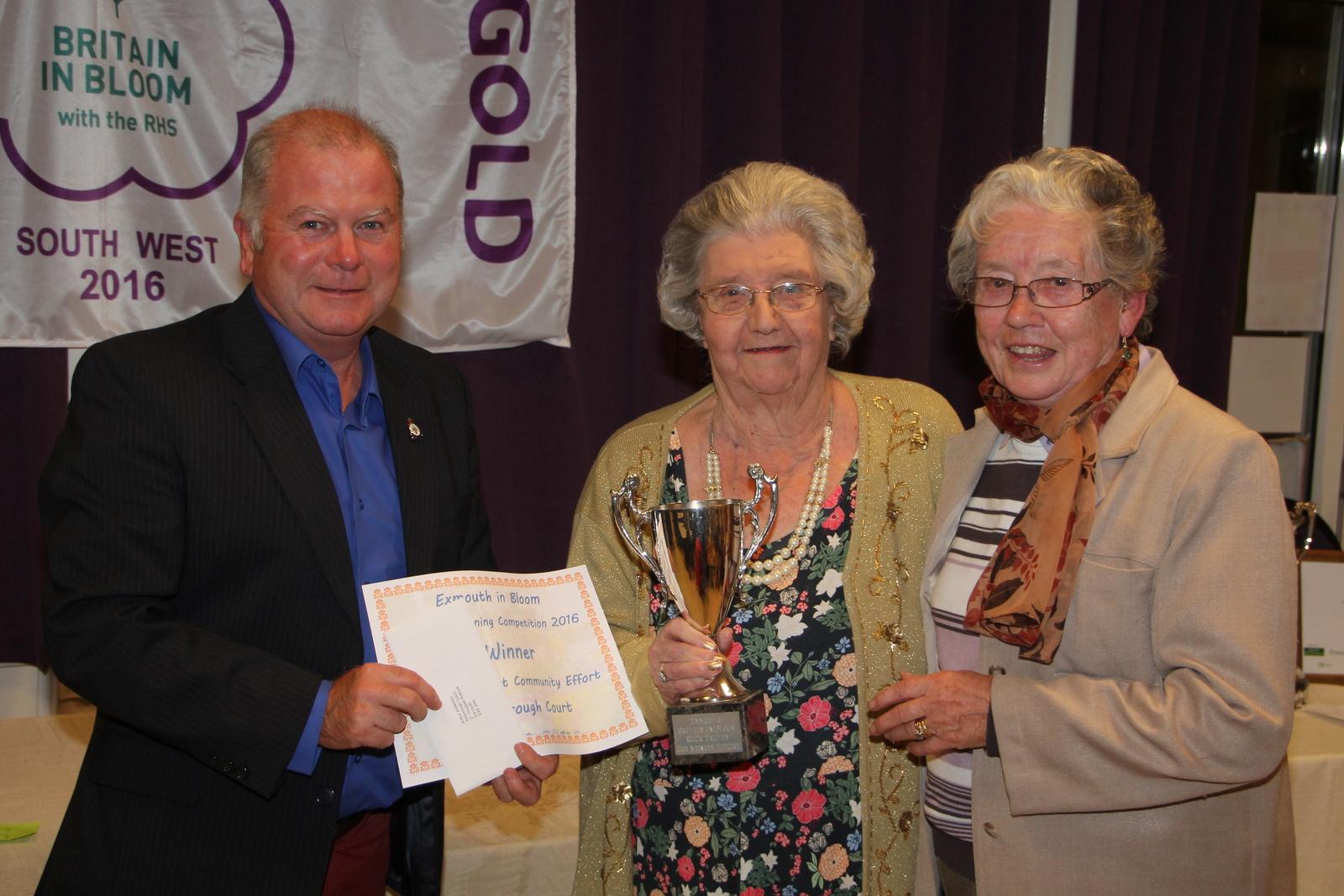 Martin & Eileen Rock present Rock Trophy for best community effort to Aldborough Court resident