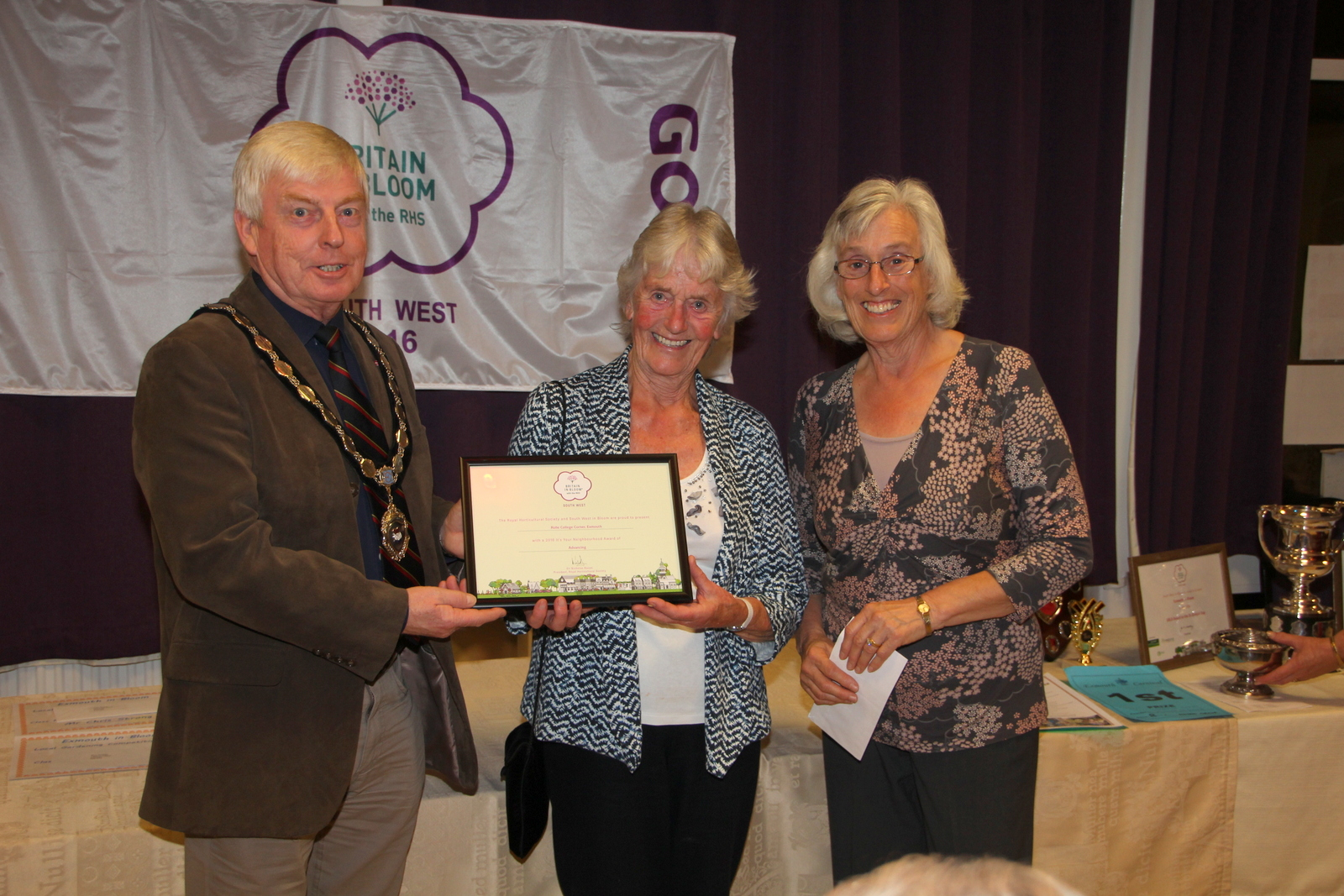 Jenny Wilmott & Elaine Lewis with 'advancing' Neighbourhood award for Rolle College corner